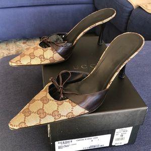 Gucci mules with original box.